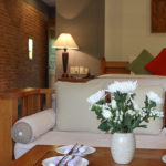 Deluxe room seating area with flowers Pilgrimage Village