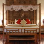 Honeymoon Pool Hut four poster bed Pilgrimage Village