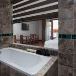 Premium Deluxe room en suite bathroom Pilgrimage Village
